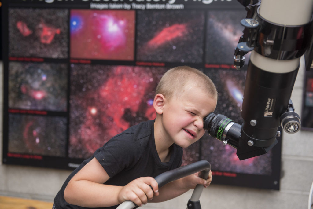 Child_Looking_Through_Telescope